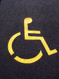 Wheelchair Parking. Yellow wheelchair symbol on parking spot stock photo