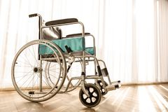 Wheelchair parking in the hospital room with sunlight in background, concept for the health care of the elderly or the disabled. stock images
