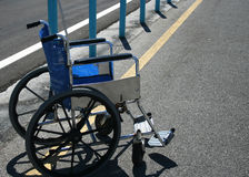 Wheelchair in parking lot Stock Images