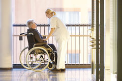Wheelchair patient nurse Royalty Free Stock Photos