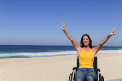 Wheelchair person enjoying outdoors beach Stock Images