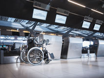 Wheelchair prepare for disability passenger at Airport Airline Check in counter Royalty Free Stock Photos