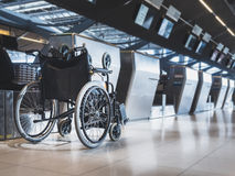 Wheelchair prepare for disability passenger at Airport Airline Check in counter. Public Facility Stock Photo