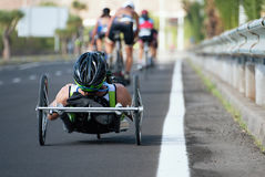 Wheelchair race cycling race triathlon participant. Para triathlete royalty free stock images
