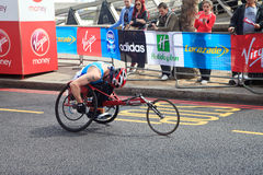 Wheelchair racer at London Marathon 2012. The London Marathon is a long-distance running event, one of the world's largest, held in London, United Kingdom. The Stock Photo