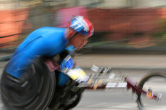 Wheelchair racer in marathon. A blurred motion shot of a wheelchair racer competing int eh 2006 new york marathon Stock Photos