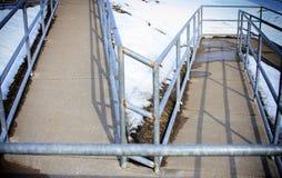 Wheelchair ramp. A long zigzagging wheelchair accessible ramp Stock Photos