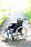 Wheelchair on the road leading to the light Royalty Free Stock Image