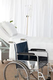 A wheelchair in a room Stock Photos