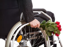 Wheelchair and roses closeup Royalty Free Stock Image