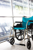 Wheelchair service in airport Royalty Free Stock Images