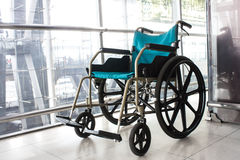 Wheelchair service in airport Royalty Free Stock Photo
