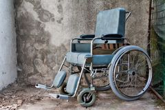 Wheelchair in a shabby place royalty free stock image