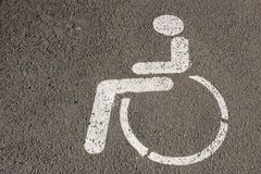 Wheelchair sign on asphalt Royalty Free Stock Photos