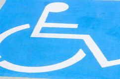 Wheelchair sign on disabled car park floor Royalty Free Stock Photos