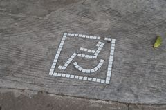 Wheelchair sign on floor Royalty Free Stock Image