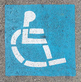 Wheelchair sign at the parking lot Royalty Free Stock Photos