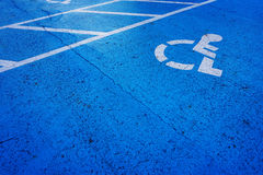 Wheelchair sign parking spot Royalty Free Stock Images