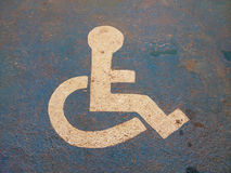 Wheelchair sign on the road Stock Images