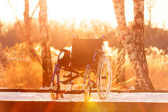 Wheelchair on the snowy road Royalty Free Stock Image