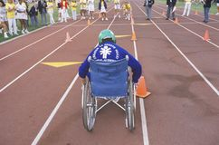 Wheelchair Special Olympics athlete. From behind, UCLA, CA Stock Photo