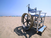 Wheelchair with stainless steel wheel rims to go in the sea Stock Photography