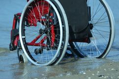 Wheelchair stuck in the sand Stock Images