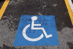 Wheelchair symbol in the car parking for disabled people Royalty Free Stock Photo