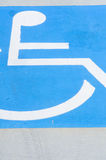 Wheelchair symbol on disabled car park floor Royalty Free Stock Image
