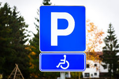 Wheelchair symbol in a Parking Lot marks disabled parking space. Stock Photos