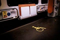 Wheelchair symbol in public transport.  Stock Photos