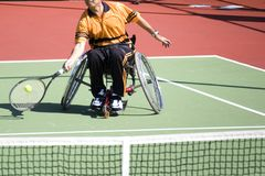 Wheelchair Tennis for Disabled Persons (Men). A wheelchair tennis player in action in an international tournament royalty free stock photos