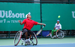 A wheelchair tennis player during a tennis championship match, t Royalty Free Stock Image