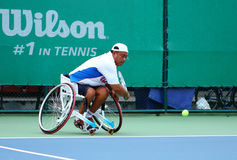 A wheelchair tennis player during a tennis championship match, t Royalty Free Stock Photography