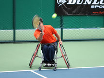 Wheelchair tennis player during a tennis championship match, tak Stock Photography
