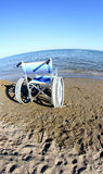 Wheelchair to ensure the mobility of disabled people on the beac Royalty Free Stock Images