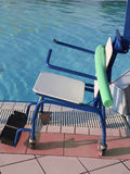 Wheelchair to enter the swimming pool for rehabilitative gymnast Royalty Free Stock Photo