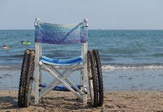 Wheelchair to move around on the sand of the beach Stock Photos