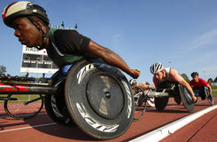 Wheelchair Track Race Men Athletes Stock Images