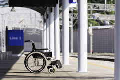 Wheelchair at train station Royalty Free Stock Photography