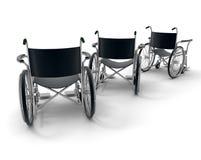 Wheelchair trio Stock Images