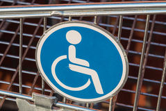 Wheelchair user disabled sign. Wheelchair user diasbled sign on a shopping cart or trolley extension for wheelchair users Stock Image