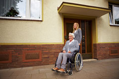 Wheelchair user in front of nursing Royalty Free Stock Images