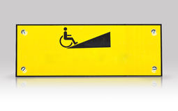 Wheelchair  way sign isolated with refection Stock Photos