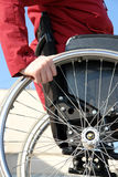 Wheelchair woman. Closeup of handicapped woman on wheelchair Royalty Free Stock Photo