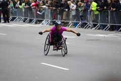 2017 NYC Marathon - Wheelchair Woman. Wheelchair woman in the 2017 NYC Marathon Stock Photo