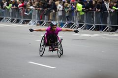2017 NYC Marathon - Wheelchair Woman. Wheelchair woman in the 2017 NYC Marathon Stock Images