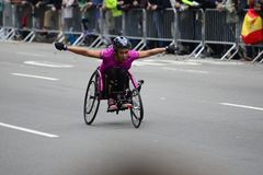 2017 NYC Marathon - Wheelchair Woman. Wheelchair woman in the 2017 NYC Marathon Stock Image