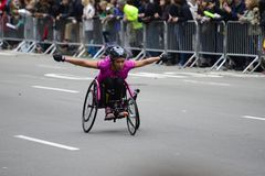 2017 NYC Marathon - Wheelchair Woman. Wheelchair woman in the 2017 NYC Marathon Royalty Free Stock Images