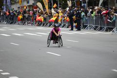 2017 NYC Marathon - Wheelchair Woman. Wheelchair woman in the 2017 NYC Marathon Stock Photography